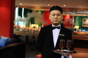 waiter or butler in uniform at five star hotel lounge